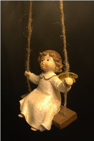 Look at this angel swing! Photo from http://www.sxc.hu/photo/1153366